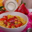 Healthy breakfast cornflakes with milk and fruits — Stock Photo #67550279