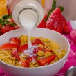 Healthy breakfast cornflakes with milk and fruits — Stock Photo #67550417