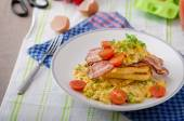 Scrambled eggs with bacon and French toast — Stock Photo