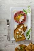 Beef tartar, toast bread with garlic — Stock Photo