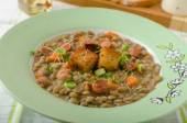 Lentil soup with Viennese sausage — Stock Photo