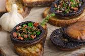 Portobello stuffed with herbs — Stock Photo