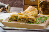 Strudel with spinach, blue cheese and garlic — Stock Photo