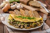 Rustic omelette with mushrooms on chives — Stock Photo