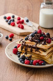 Homemade belgian waffles with fruit and chocolate — Stock Photo