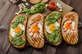 Vatiations of fried eggs inside bread — Stock Photo