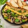 Omelet with mushrooms, lambs lettuce, herbs and chilli — Stock Photo #78312616