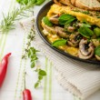 Omelet with mushrooms, lambs lettuce, herbs and chilli — Stock Photo #78312688