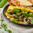 Omelet with mushrooms, lambs lettuce, herbs and chilli — Stock Photo #78312784