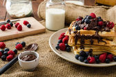 Waffles with fruits and chocolate — Stock Photo