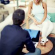 Blonde hair female executive at the conference outdoors, businesswoman discussing plan with male colleague at meet — Stock Photo #56646921