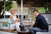 Young businessman discussing plan with colleague at work break, business team of two successful people working with computer — Stockfoto