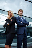 Confident business team of man and woman standing with crossed hands, team spirit concept, couple of success business people ready to act, business manager and employee,ready to implement plans — Stock Photo