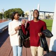 Full length of cheerful university students walking on campus, young stylish students walking during the break, friends having a great time together, two college friends laughing having good time — Stock Photo #60463967