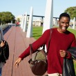 Friends having a great time together, two college friends laughing having good time, african couple smiling each to other at beautiful day two students smiling at college campus, happy people laughing — Stock Photo #60463981