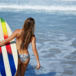 Sexy woman in swimsuit running to ocean waves holding her surfboard, hot surfer girl running to waves with her surfboard, beautiful young woman in bikini with surfboard run ready to surfing — Stock Photo #60540763