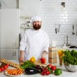 Professional cook in uniform — Stock Photo #64460663