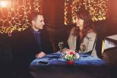 Young couple while romantic dinner — Stock Photo