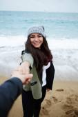 Happy woman holding her boyfriends hand — Stock Photo