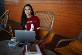 Female designer sitting in coffee shop — Stock Photo