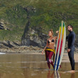 Surfers getting ready to ride — Stock Photo #69202087