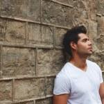 Man leaning on brick wall — Stock Photo #69202939