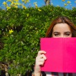 Young woman with pink book — Stock Photo #69203427