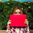 Young woman with pink book — Stock Photo #69203439