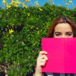 Young woman with pink book — Stock Photo #69203487