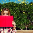 Young woman with pink book — Stock Photo #69203545