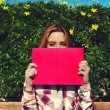 Young woman with pink book — Stock Photo #69203675
