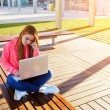 Female student focused using laptop — Stock Photo #69204887