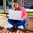 Student sitting with open laptop computer — Stock Photo #69205275