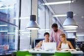 University students learning in library — Stock Photo