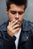 Man with cigarette in his mouth — Stock Photo
