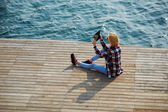 Woman taking a photo of a beautiful view — Stock Photo