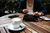 Woman using busy digital tablet — Stock Photo