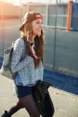 Pretty girl walking outdoors in the street — Stock Photo