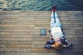 Woman lying on a wooden jetty — Stock Photo