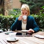 Businesswoman while coffee break — Stock Photo #73328793