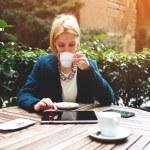 Businesswoman while coffee break — Stock Photo #73328797
