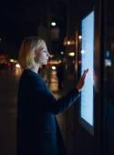 Woman using modern urban application — Stock Photo