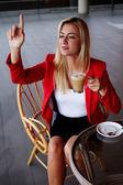 Businesswoman calling for waiter — Stock Photo