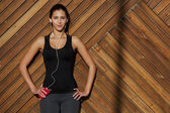 Woman in sportswear listening music with headphones — Stock Photo