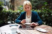 Businesswoman while coffee break — Stock Photo