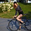 Stylish hipster girl on bike — Stock Photo #73330235