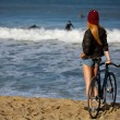 Hipster girl relaxing on the beach wit bicycle — Stock Photo #73330337