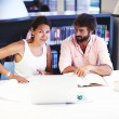 Students studying together at university library — Stock Photo #73330589