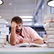 Caucasian male student sitting with books — Stock Photo #73330679