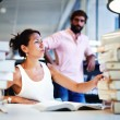 Students in library having fun — Stock Photo #73330791